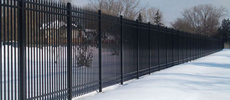 steel picket fence in snow