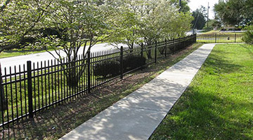steel picket fence next to street